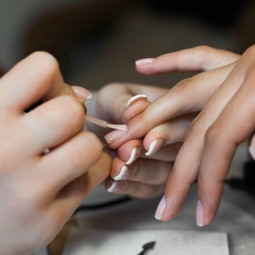 hands having nails painted